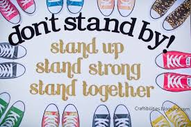 dont stand by stand up stand strong stand together